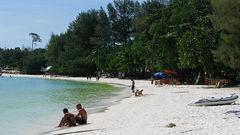 På populære Pattaya Beach er sanden som melis.